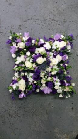 purple and white cushion