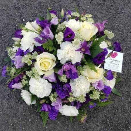 Purple/white funeral posy arrangement