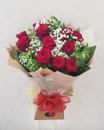 Red roses in boxed bouquet
