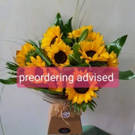 Sunflower bouquet in water