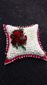 large red and white based cushion