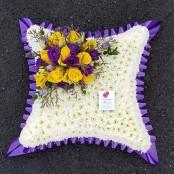 Large yellow, purple and white cushion