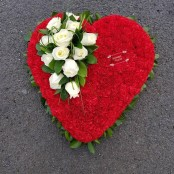 carnation based heart with roses spray