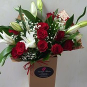 12 red roses with whilte lilies